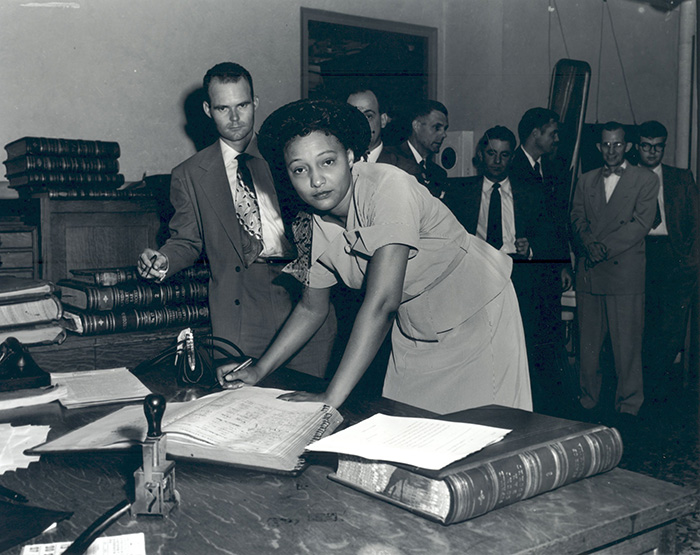 Ada Sipuel Fisher signing the register of attorneys, 1952