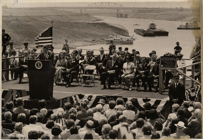 President Nixon gives a speech with the Verdigris River and river vessels in the background on June 5, 1971.