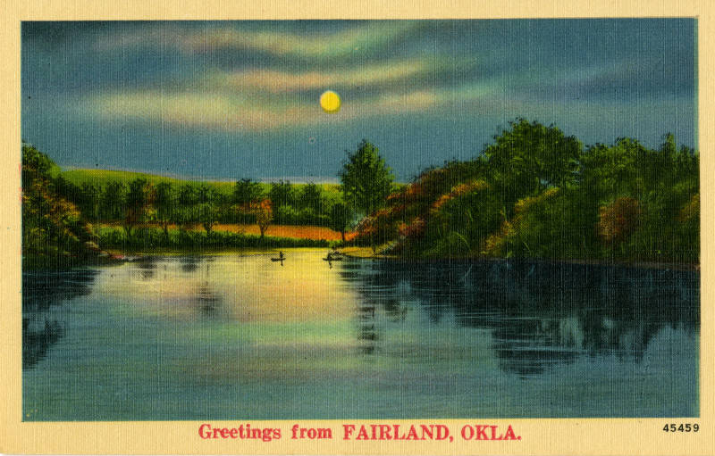 view of a lake in Fairland at sunset with trees